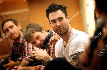 """Maroon 5 Members of American rock band Maroon 5, lead singer Adam Levine, right, Mickey Madden, center, and Jesse Carmichael, left, give a press conference at the Singapore Indoor Stadium before their concert as part of their tour in support of their album """"Hands All Over"""" on in Singapore"""