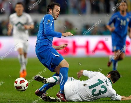 Gianpaolo Pazzini, Bojan Jokic Italy's Gianpaolo Pazzini, left, is challenged by Slovenia's Bojan Jokic during their Euro 2012, group C qualifying match in Ljubljana, Slovenia