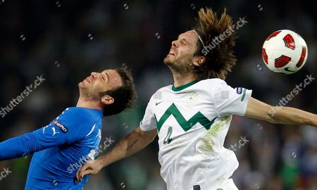 Gianpaolo Pazzini, Marko Suler Italy's Gianpaolo Pazzini, left, is challenged by Slovenia's Marko Suler during their Euro 2012, group C qualifying match in Ljubljana, Slovenia