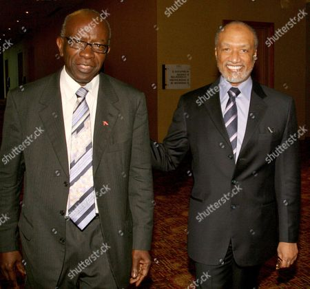 Stock Picture of Mohamed bin Hammam, Austin Jack Warner FILE - In this May 10, 2011 file picture Mohamed bin Hammam, right, of Qatar, chief of the Asian Football Confederation, is accompanied by FIFA Vice President Austin Jack Warner, of Trinidad & Tobago, during a meeting in Port of Spain, Trinidad & Tobago. FIFA suspended Mohamed bin Hammam and Jack Warner on amid allegations the two executive committee members bribed voters in the presidential election campaign. The FIFA ethics committee, meanwhile, cleared FIFA president Sepp Blatter of turning a blind eye to the alleged bribes. The decision clears the way for Blatter to be re-elected unopposed to a fourth term on Wednesday. FIFA said bin Hammam, a Qatari who heads Asia's football confederation, and Warner, a FIFA vice president from Trinidad, will now face a full FIFA inquiry. If found guilty, they could be expelled from FIFA and banned from all football activity