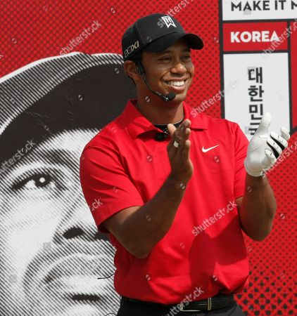 Tiger Woods U.S. golfer Tiger Woods reacts during a golf clinic with South Korean young golfers as part of his Asian tour at the Jade Palace Golf Club in Chuncheon, South Korea