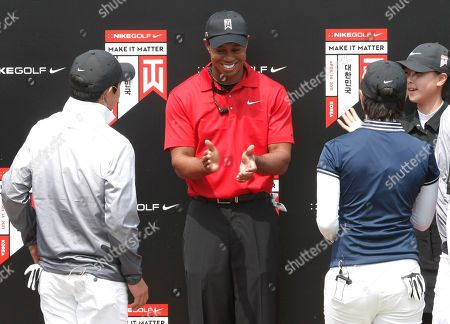 Tiger Woods U.S. golfer Tiger Woods, center, reacts after a golf clinic with South Korean young golfers as part of his Asian tour at the Jade Palace Golf Club in Chuncheon, South Korea