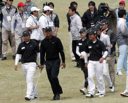 Tiger Woods U.S. golfer Tiger Woods, second from left, walks with South Korean young golfers during a golf clinic as part of his Asian tour at the Jade Palace Golf Club in Chuncheon, South Korea
