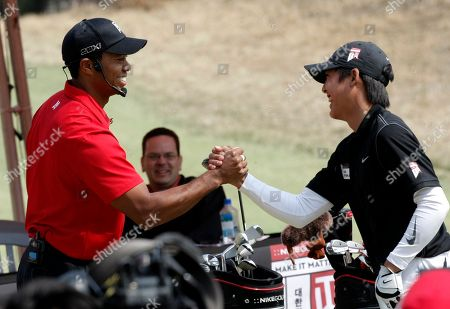 Stock Picture of Tiger Woods U.S. golfer Tiger Woods, left, shakes hands with South Korean young golfer Cho Byeong-jae during a golf clinic as part of his Asian tour at the Jade Palace Golf Club in Chuncheon, South Korea