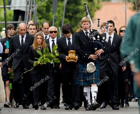 Seve Ballesteros, Javier Ballesteros, Carmen Ballesteros, Miguel Ballesteros A musician, front, plays the bagpipes as Seve Ballesteros' oldest son, Javier, carries the urn holding the Spanish golfer's ashes, flanked by his sister, Carmen, left, holding flowers and their brother, Miguel, right, in honor of Spanish professional golfer Seve Ballesteros, during his funeral service in Pedrena, Spain, . Ballesteros, 54, a five-time major tournament winner, died last Saturday of from complications of a cancerous brain tumor