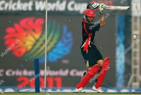 Canada's cricketer John Davison plays a shot during a practice session at the Mahinda Rajapaksa International Cricket Stadium in Hambantota, Sri Lanka