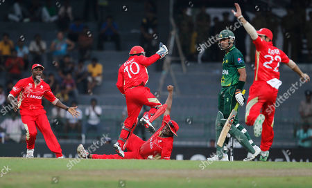 Wahab Riaz, Balaji Rao Canada's Balaji Rao, on the ground, completes a catch to dismiss Pakistan's Wahab Riaz, second right, as others celebrate during the ICC Cricket World Cup match between Canada and Pakistan in Colombo, Sri Lanka