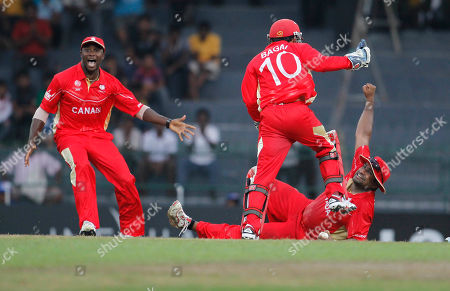 Balaji Rao, Ashish Bagai Canada's Balaji Rao, on the ground celebrates after completing a catch to dismiss Pakistan's Wahab Riaz, unseen, with captain Ashish Bagai during the ICC Cricket World Cup match between Canada and Pakistan in Colombo, Sri Lanka