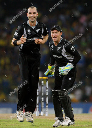 Andy McKay, Brendon McCullum New Zealand's bowler Andy McKay, left, celebrates with wicket keeper Brendon McCullum after taking the wicket of Sri Lanka's captain Kumar Sangakkara during the Cricket World Cup semifinal match between Sri Lanka and New Zealand in Colombo, Sri Lanka