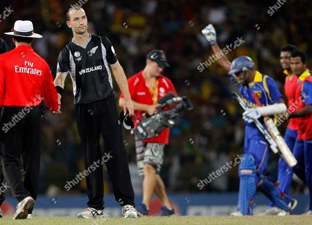 Andy McKay, Thilan Samaraweera New Zealand's bowler Andy McKay, second from left, shakes hands with umpire Aleem Dar as Sri Lanka's batsman Thilan Samaraweera, back right, celebrates the victory by five wickets during the Cricket World Cup semifinal match between Sri Lanka and New Zealand in Colombo, Sri Lanka