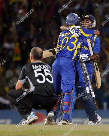 Mahela Jayawardene, Thilan Samaraweera, Andy McKay Sri Lanka's Mahela Jayawardene, right, and Thilan Samaraweera, center, celebrate as New Zealand's bowler Andy McKay, foreground left, looks on after winning the Cricket World Cup semifinal match between Sri Lanka and New Zealand in Colombo, Sri Lanka