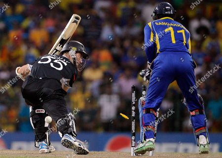Andy McKay, Kumar Sangakkara New Zealand's Andy McKay, left, is bowled for a duck by Sri Lanka's Ajantha Mendis, unseen, as wicket keeper Kumar Sangakkara looks on during the Cricket World Cup semifinal match between Sri Lanka and New Zealand in Colombo, Sri Lanka