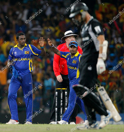 Ajantha Mendis, Rangana Herath, Andy McKay Sri Lanka's bowler Ajantha Mendis, left, is congratulated by fellow team member Rangana Herath, second from left, after bowling out New Zealand's Andy McKay, foreground right, during the Cricket World Cup semifinal match between Sri Lanka and New Zealand in Colombo, Sri Lanka