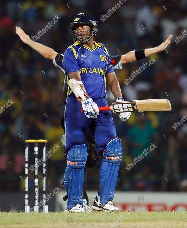 Kumar Sangakkara, Andy McKay Sri Lankan batsman Kumar Sangakkara, front, leaves the pitch as New Zealand's bowler Andy McKay, partially visible in back, celebrates during Cricket World Cup semifinal match between New Zealand and Sri Lanka in Colombo, Sri Lanka