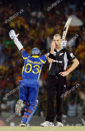 Stock Picture of Thilan Samaraweera, Andy McKay Sri Lanka's batsman Thilan Samaraweera, left, celebrates after scoring the winning runs to beat New Zealand by five-wickets as New Zealand's Andy McKay looks on during the Cricket World Cup semifinal match between Sri Lanka and New Zealand in Colombo, Sri Lanka