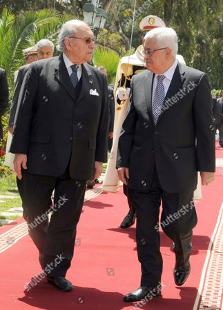 Mahmoud Abbas, Beji Caid Essebsi Tunisian President Fouad Mebazaa, left, and Palestinian President Mahmoud Abbas review an honor guard prior to their meeting at the Presidential Palace in Carthage, outside Tunis, . Abbas is on a three-day official visit to Tunisia
