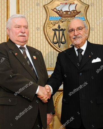 Stock Image of Fouad Mebazaa, Lech Walesa Tunisia's interim president, Fouad Mebazaa, right, shakes hands with Polish former president and Solidarity founder Lech Walesa in Tunis, Thursday April, 208, 2011. During a three-day visit, Walesa is to meet members of Tunisia's interim legislative body, human rights and pro-democracy activists. Tunisia's longtime president fled in a popular revolt this year