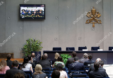 Journalists follow on monitors as astronauts talks to Pope Benedict XVI, at the Vatican, . The 12 astronauts circling the Earth have received a call from Pope Benedict XVI, the first-ever papal call to space. The pope addressed the shuttle and station crews from the Vatican. Two Italians are on board: Endeavour astronaut Roberto Vittori and International Space Station resident Paolo Nespoli. The pope said he admired the astronauts' courage, discipline and commitment