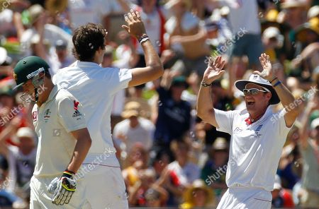 Marcus North, Andrew Strauss, Steve Finn England's captain Andrew Strauss, right, celebrates with teammate Steve Finn as Australia's Marcus North walks off during the first day of their second Ashes cricket test in Adelaide, Australia