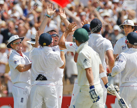 Graeme Swann England's Graeme Swann, third from left, celebrates after taking the wicket of Australia's Marcus North on day five of the second Ashes cricket test in Adelaide, Australia, . Swann took three wickets in the first session as England won the second Ashes test by an innings and 71 runs after Australia collapsed to 304 all out before lunch on the final day