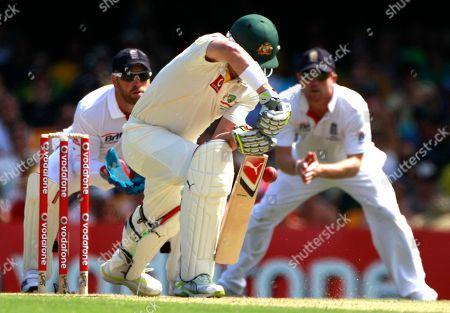 Australia's Marcus North, center, edges the ball to be caught in slips by England's Paul Collingwood, right, for 1 run during the second day of the first Ashes cricket test in Brisbane, Australia, . Australia are chasing England's first innings score of 260