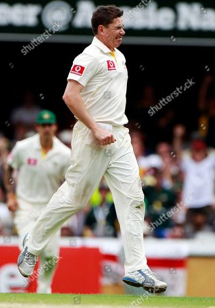 Australia's Marcus North winks after England's Andrew Strauss was stumped for 110 runs off North's bowling during the fourth day of the first Ashes cricket test in Brisbane, Australia