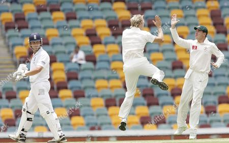 Jonathan Trott England's Jonathan Trott, left, looks back as Australia's Shane Watson and Marcus North celebrate after Trott was bowled out by Watson for 29 runs during the 1st day of the first test in the Ashes cricket series between Australia and England at the Gabba in Brisbane, Australia