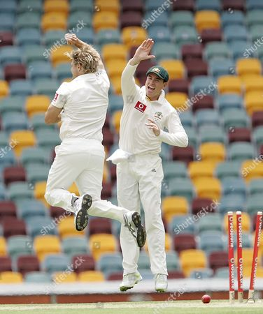 Shane Watson, Marcus North Australia's Shane Watson, left, and Marcus North, right, celebrate after Watson got the wicket of Jonathan Trott bowled out for 29 runs during the 1st day of the first test in the Ashes cricket series between Australia and England at the Gabba in Brisbane, Australia