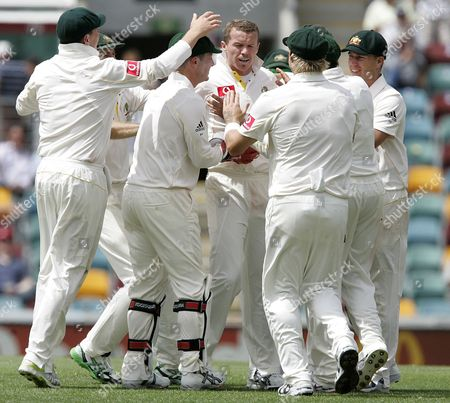Peter Siddle Australia's Peter Siddle, center, is mobbed by his teammates after getting the wicket of Paul Collingwood, caught by Marcus North, for 4 runs during the 1st day of the first test in the Ashes cricket series between Australia and England at the Gabba in Brisbane, Australia