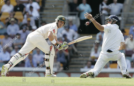 Marcus North, Alastair Cook Australia's Marcus North plays a shot past England's Alastair Cook, right, during the second day of their first test in the Ashes cricket series at the Gabba in Brisbane, Australia