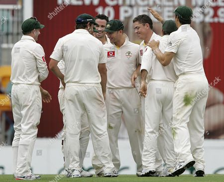 Marcus North Australia's Marcus North, 3rd from right, celebrates with his team after getting the wicket of Andrew Strauss during the 4th day of the first test in the Ashes cricket series between Australia and England at the Gabba in Brisbane, Australia