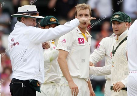 Billy Bowden, Michael Beer, Michael Clarke Umpire Billy Bowden, left, gestures as Australian players Michael Beer center, and Michael Clarke, right, look on as a decision is referred to the third umpire during the second day of the fifth and final Ashes cricket test at the Sydney Cricket Ground, Sydney, Australia