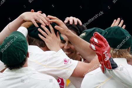 Mitchell Johnson Michael Beer Hands pat the heads of Australia's Mitchell Johnson center, and Michael Beer left, as they celebrates taking the wicket of England's Kevin Pietersen on the second day of play in the fifth Ashes Test Match in Sydney, Australia