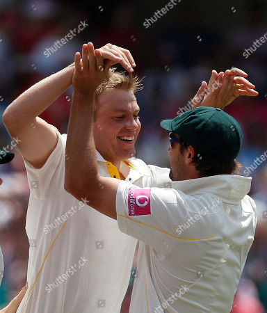 Ben Hilfenhaus Michael Beer Australia's Michael Beer, left, celebrates with Ben Hilfenhaus after taking the wicket of England's Paul Collingwood on the third day of the fifth and final Ashes cricket test at the Sydney Cricket Ground in Sydney, Australia