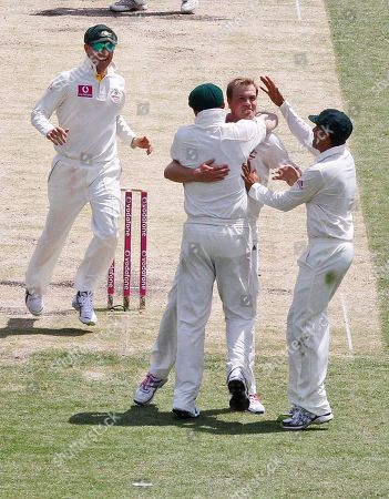 Peter Siddle Michael Beer Michael Hussey Australia's Michael Beer, center, celebrates and hugs Peter Siddle, and Michael Hussey after taking the wicket of England's Paul Collingwood on the third day of the fifth and final Ashes cricket test at the Sydney Cricket Ground in Sydney, Australia