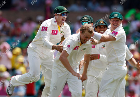Peter Siddle, Michael Beer, Michael Hussey Australia's Peter Siddle right, celebrates with Michael Beer, center, and Michael Hussey after taking the wicket of England's Paul Collingwood on the third day of play in the 5th Ashes Test Match in Sydney, Australia