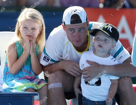 Lleyton Hewitt, Mia Hewitt, Cruz Hewitt Australia's Lleyton Hewitt embraces his children Cruz and Mia, left, as he waits for the trophy presentation after defeating France's Gael Monfils in the final of the Kooyong Classic in Melbourne, Australia