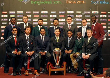 CORRECTS IDENTITY OF NETHERLANDS PLAYER The 14 national captains, front l-r, Canada's Ashish Bagai, Netherlands Bas Zuiderent (vice captain), Sri Lanka's Kumar Sangakkara, Australia's Ricky Ponting, Bangladesh's Shakib Al Hasan, Kenya's Jimmy Kamande and Ireland William Porterfield, (Back Row L-R) Zimbabwe's Elton Chigumbura, New Zealand's Daniel Vettori, Pakistan Shahid Afridi, India's Mahendra Singh Dhoni, South Africa's Graeme Smith, England's Andrew Strauss and West Indies Darren Sammy posing with the ICC Cricket World Cup trophy in Dhaka, Bangladesh on . The opening ceremony for the tornament starts later Thursday