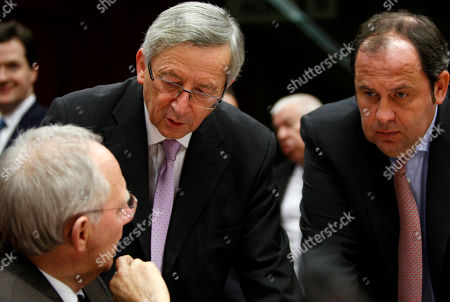 Jean Claude Juncker, Josef Proell, Wolfgang Schaeuble From left, German Finance Minister Wolfgang Schaeuble, Luxembourg's Finance Minister Jean Claude Juncker and Austrian Finance Minister Josef Proell share a word during a meeting of eurozone finance ministers regarding the euro stability mechanism at the EU Council building in Brussels on . European ministers face a potential flare-up in the euro's debt crisis when they meet Monday as investors increasingly worry they might not deliver on their promise of a comprehensive solution
