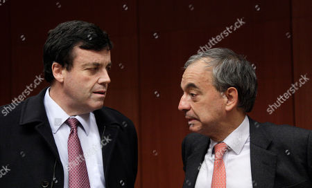 Brian Lenihan, Charliaos Stavrakis Cypriot Finance Minister Charliaos Stavrakis, right, speaks with Irish Finance Minister Brian Lenihan during a meeting of eurogroup finance ministers at the EU Council building in Brussels, . Finance ministers of the 17 euro countries are locking horns Monday over how to fight their crippling debt crisis amid evidence that the European Central Bank has so far been taking on the burden of calming jittery bond markets