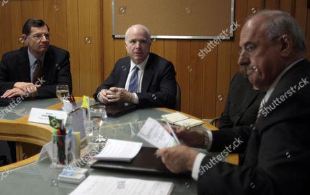 John McCain, Nelson Jobim U.S. Sen. John McCain, R-Ariz., second from left, speaks to Brazil's Defense Minister Nelson Jobim, right, during a meeting in Brasilia, Brazil, . McCain is on a two-day official visit to Brazil