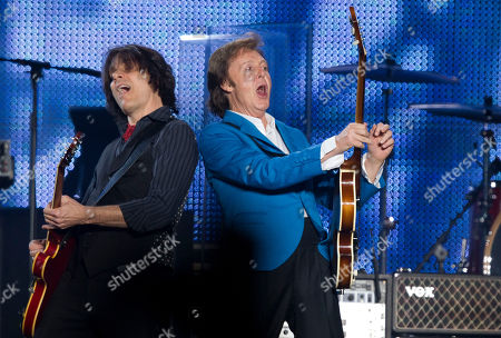 "Paul McCartney, Rusty Anderson British singer Paul McCartney, right, and guitarist Rusty Anderson perform during the ""Up And Coming Tour"" at the Morumbi stadium in Sao Paulo, Brazil"