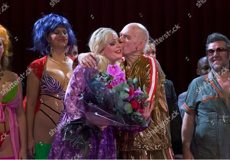 Eva-Maria Westbroek, Alan Oke Anna Nicole played by actress Eva-Maria Westbroek receives a kiss from J. Howard Marshall II played by Alan Oke at the curtain call of Anna Nicole: An Opera in Two Acts, at the Royal Opera House in London