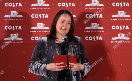 """Jo Shapcott Winner of the Costa Book of the Year Award Jo Shapcott reacts after winning the award in London Tuesday, Jan., 25, 2011. A book of poetry inspired in part by the writer's experience of breast cancer was hailed as """"a celebration of life"""" tonight as it carried off a major literary prize. Shapcott's surprise victory for her book, Of Mutability, makes it two years in a row that poetry has won the Costa Book Award"""