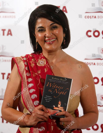 Edmund de Waal Author Kishwar Desai, the Costa First Novel Award winner and shortlisted for the Costa Book of the Year poses for the media holding her book ' Witness ther Night ' at the awards ceremony in London