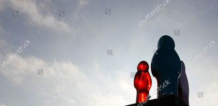 A sculpture by Mauro Perucchetti, entitled 'Jelly Baby Family' is seen near London's Marble Arch