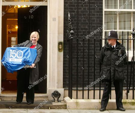 Larry Claire Horton CEO of Battersea Dogs and Cats Home arrives at 10 Downing Street in London, carrying Larry, carefully hidden in a cocvered cage, Downing Street's new official rat catcher. The feline weapon has been taken on after a rodent was spotted scuttling past live TV cameras twice last month. It is the first such official appointment since stalwart ratter Humphrey was retired in 1997, shortly after Tony Blair arrived in Downing Street