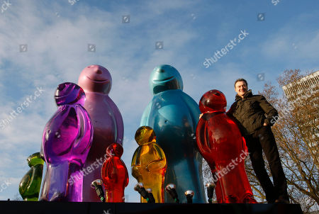 Mauro Perucchetti Italian sculptor Mauro Perucchetti stands on his sculpture 'The Jelly Baby Family' after it was erected in Marble Arch in central London, . The sculpture weighing 3.2 tonnes and over 3 metres tall forms part of Westminster Council's City of Sculpture Festival which will include installations donated by some of the world's leading galleries and artists