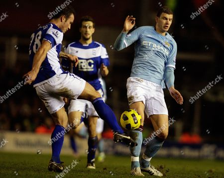 Birmingham City's Martin Jiranek left, competes for the ball with Manchester City's Edin Dzeko during their English Premier League soccer match at St' Andrews stadium, Birmingham, England, . (AP Photo/Simon Dawson)NO INTERNET/MOBILE USAGE WITHOUT FOOTBALL ASSOCIATION PREMIER LEAGUE (FAPL) LICENCE. CALL +44