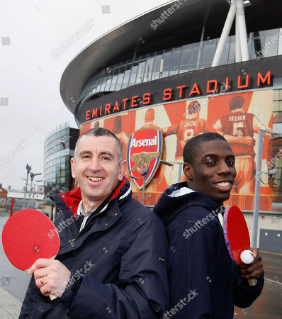 Nigel Winterburn, Darius Knight Former Arsenal soccer player Nigel Winterburn, left, meets table tennis champion Darius Knight, right, at Arsenal's Emirates Stadium in London, ahead of the Urban Cup competition, . There's a new cup competition involving the Premier League in town, and the trophy will be held aloft by a team of inner city kids who play table tennis.The Urban Cup is a ping pong tournament aimed at getting underprivileged kids off the streets and involved in the sport, and this year's event is going to feature Manchester United, Arsenal, Chelsea and the rest of the Premier League teams